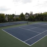 two tennis courts by home court