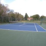 blue surface tennis court by home court